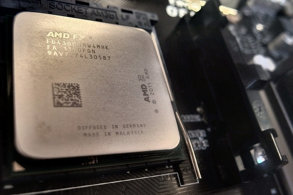 An AMD FX CPU ready to have thermal paste reapplied